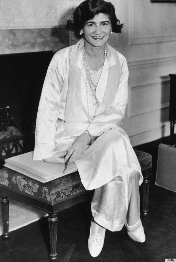 10th March 1931: Portrait of French fashion designer Gabrielle 'Coco' Chanel (1883 - 1971) posing in her suite at the Hotel Pierre during her first visit to New York City. She wears a white silk jacket and pants with pearls. (Photo by New York Times Co./Getty Images)